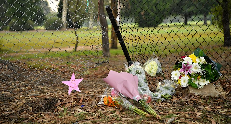 Flowers placed at the scene where seven children were hit on a footpath by a four-wheel drive in the Sydney suburb of Oatlands, Sunday, February 2, 2020. Four children have died and a fifth is in a critical condition after they were hit by a four-wheel drive while on the footpath in Sydney's northwest. (AAP Image/Joel Carrett) NO ARCHIVING