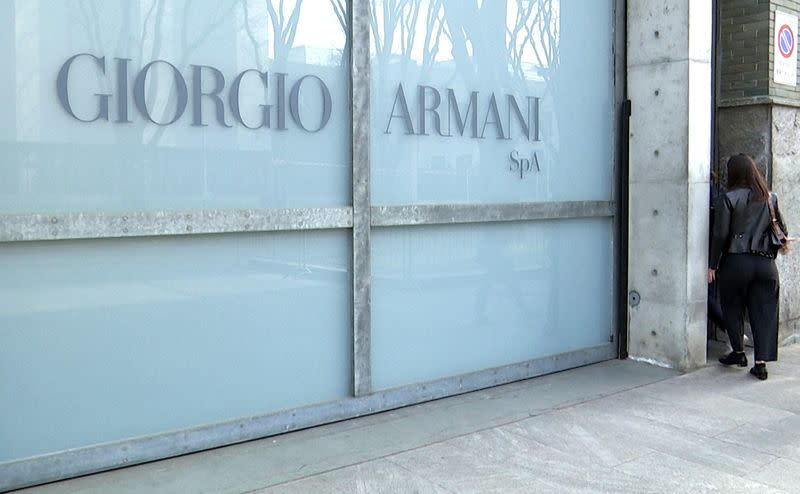 Italy's Armani converts fashion sites to produce medical overalls