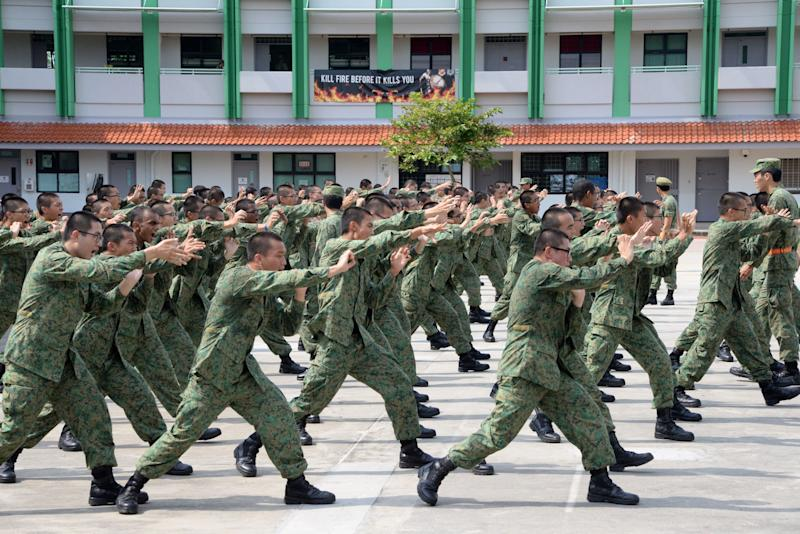 National Service recruits demonstrate hand-to-hand combat moves as part of their two-month long basic training on Pulau Tekong off Singapore on February 7, 2017. Singapore will keep its mandatory military service because it cannot depend on help from others in an uncertain world, the city-state's defence minister said February 7. / AFP / TOH TING WEI (Photo credit should read TOH TING WEI/AFP via Getty Images)