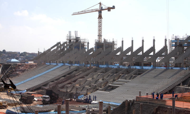 A view showing the site of the ongoing construction of what will be the new soccer stadium in Sao Paulo, Brazil, Tuesday March 6, 2012. The stadium, expected to seat as many as 65,000, will host the opening match of the World Cup in 2014 on June 12, located in the Itaquera neighborhood.  (AP Photo/Andre Penner)