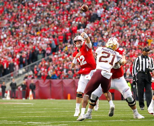 """Wisconsin quarterback <a class=""""link rapid-noclick-resp"""" href=""""/ncaaf/players/251340/"""" data-ylk=""""slk:Alex Hornibrook"""">Alex Hornibrook</a> (12) during the first half of an NCAA college football game against Minnesota Saturday, Nov. 24, 2018, in Madison, Wis. (AP Photo/Andy Manis)"""