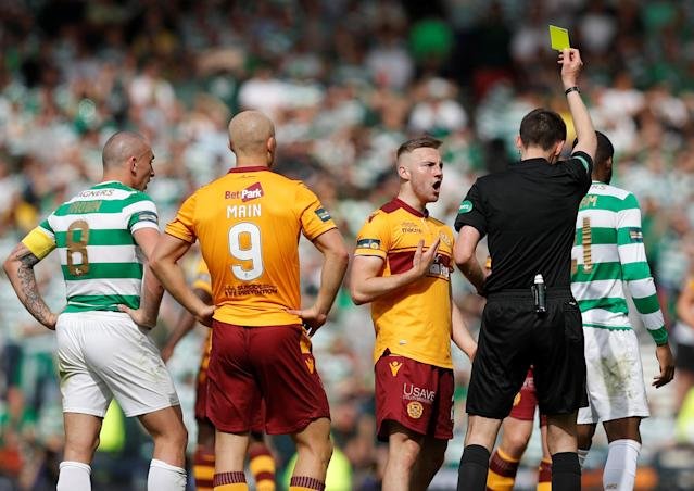 Soccer Football - Scottish Cup Final - Celtic vs Motherwell - Hampden Park, Glasgow, Britain - May 19, 2018 Motherwell's Allan Campbell is shown a yellow card by referee Kevin Clancy REUTERS/Russell Cheyne
