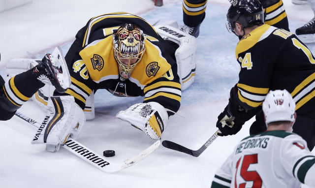 Boston Bruins goaltender Tuukka Rask (40) pounces onto the puck during the third period of the team's NHL hockey game against the Minnesota Wild in Boston, Tuesday, Jan. 8, 2019. The Bruins defeated the Wild 4-0. (AP Photo/Charles Krupa)