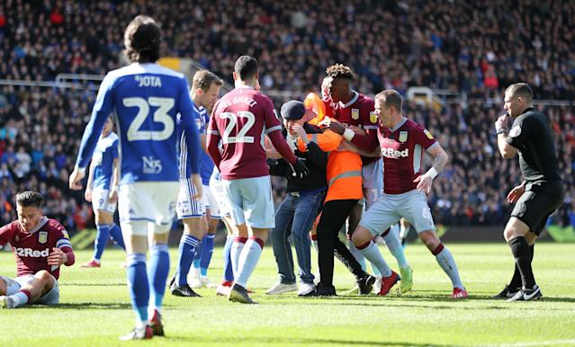 Birmingham City fan Paul Mitchell is restrained after attacking Jack Grealish. (Credit: PA)