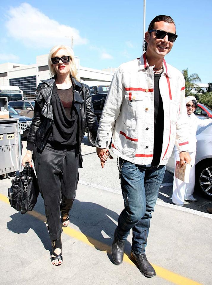 "Despite Courtney Love's announcement last week to Howard Stern that she was at one time romantically involved with Gavin Rossdale, he and his wife Gwen Stefani were all smiles upon arriving at the Los Angeles International Airport. On his Facebook page, Rossdale responded to Love's claim: ""Gwen and Gavin Rossdale would like to assure their fans that anything that may have occurred prior to their marriage has no impact on their current situation. All is well with the Rossdale family."" <a href=""http://www.splashnewsonline.com/"" target=""new"">Splash News</a> - May 2, 2010"
