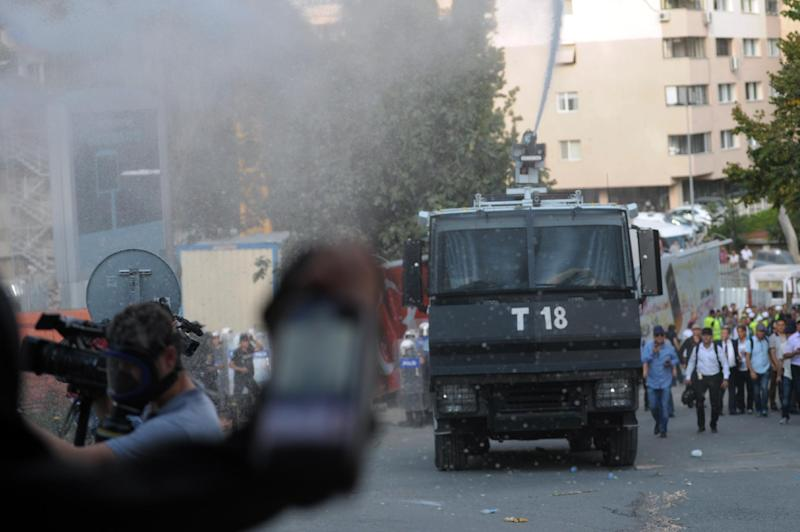 Turkish riot police and protestors clash on September 7, 2014 in Istanbul. Police fired tear gas and water cannon at protesters a day after 10 workers were killed when a lift crashed to the ground