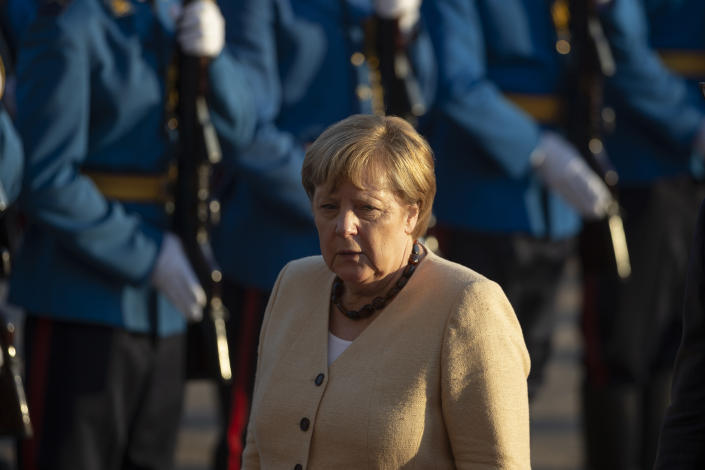 German Chancellor Angela Merkel walks past honor guards during her visit to Belgrade, Serbia, Monday, Sept. 13, 2021. Merkel is on a farewell tour of the Western Balkans, as she announced in 2018 that she wouldn't seek a fifth term as Germany's Chancellor. (AP Photo/Marko Drobnjakovic)