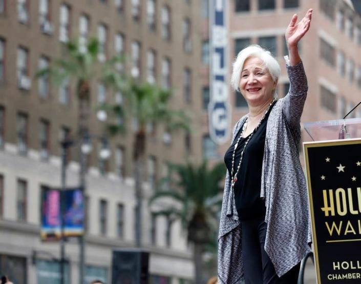 Dukakis waves at the ceremony for the unveiling of her star on the Walk of Fame in Los Angeles