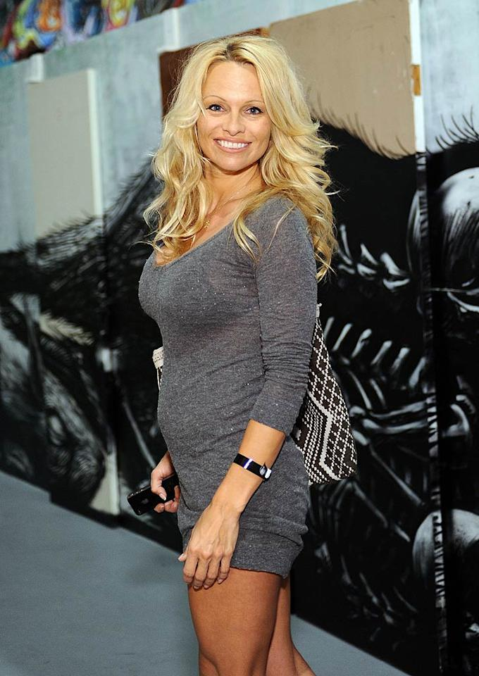 "Pamela Anderson was all smiles in her mini dress. Think her look is hot ... or not? Stefanie Keenan/<a href=""http://www.wireimage.com"" target=""new"">WireImage.com</a> - April 14, 2011"