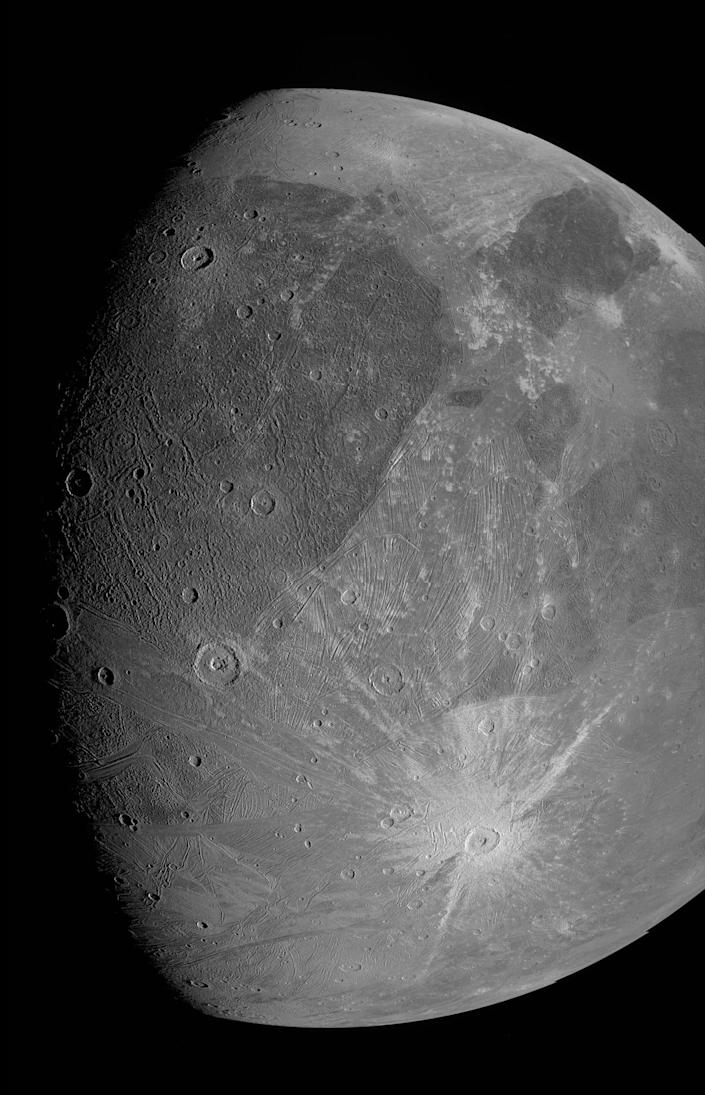 ganymede crate gray moon half shrouded in darkness
