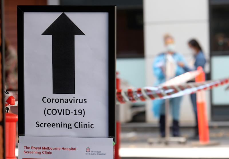 MELBOURNE, AUSTRALIA - MARCH 11: A sign directing people to the COVID-19 screening area is posted outside the Royal Melbourne Hospital on March 11, 2020 in Melbourne, Australia. Seven coronavirus screening clinics are now open in Victoria to help avoid the further spread of COVID-19. 18 people in Victoria have now been diagnosed with the virus, with the Australian total of confirmed cases now at 100.(Photo by Luis Ascui/Getty Images)