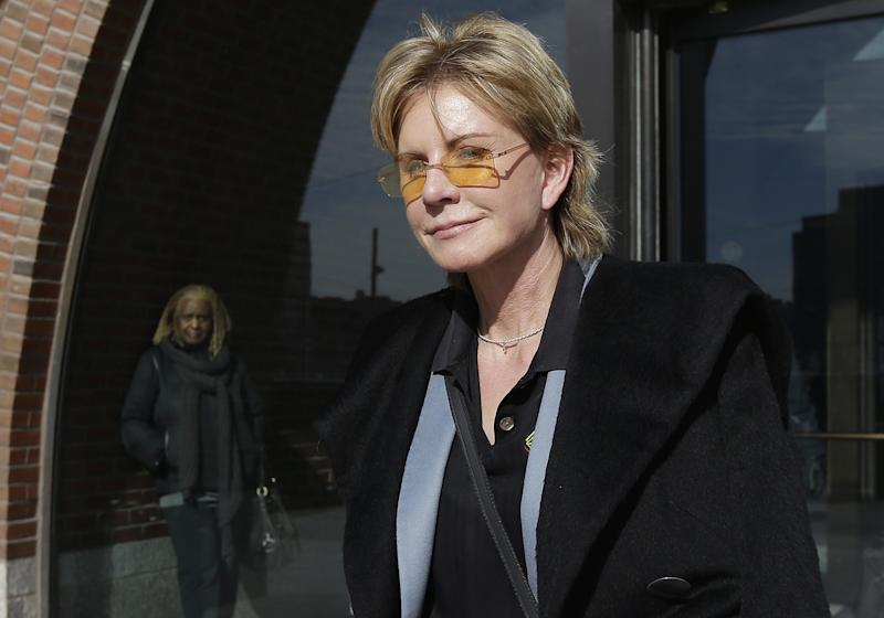 FILE - In a Feb. 7, 2013 file photo, author Patricia Cornwell leaves federal court in Boston after she took the stand in her lawsuit against her former financial management company.  A federal jury awarded crime writer Patricia Cornwell nearly $51 million Tuesday, Feb. 19, 2013, in her lawsuit against her former financial management company and a former principal in the firm. Cornwell claimed that the firm and a former executive cost her millions of dollars in losses or unaccounted revenue during their four-year relationship. (AP Photo/Steven Senne)