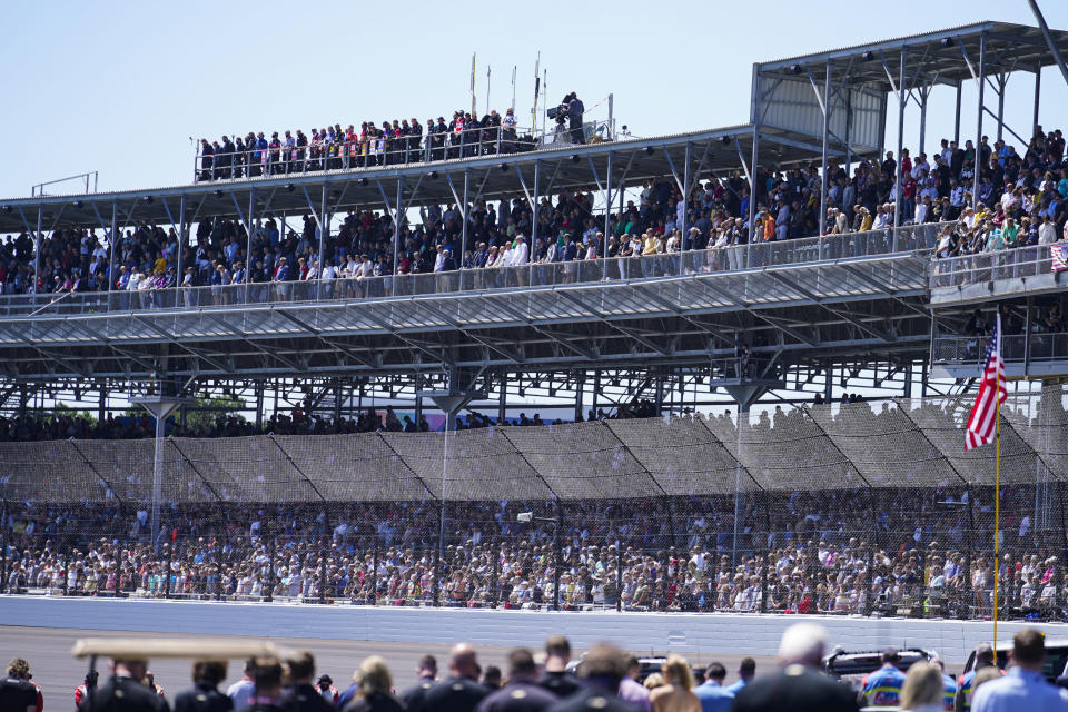 Fans fill the stands before the Indianapolis 500 auto race at Indianapolis Motor Speedway in Indianapolis, Sunday, May 30, 2021. About 135,000 spectators, about 40% of the speedway's capacity, were admitted to the track for the largest sports event since the start of the pandemic. (AP Photo/Michael Conroy)