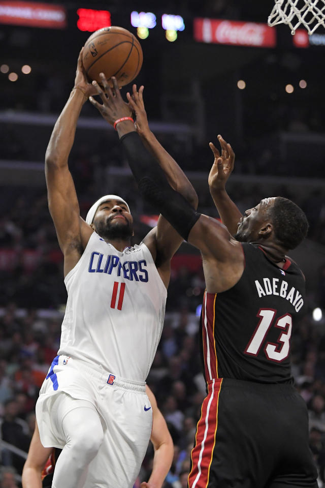 Los Angeles Clippers forward Maurice Harkless, left, shoots as Miami Heat forward Bam Adebayo defends during the first half of an NBA basketball game Wednesday, Feb. 5, 2020, in Los Angeles. (AP Photo/Mark J. Terrill)