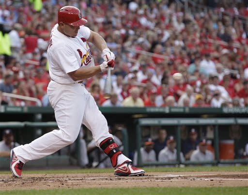 St. Louis Cardinals' Matt Holliday swings on a solo home run in the first inning of a baseball game against the Houston Astros, Tuesday, July 9, 2013, in St. Louis.(AP Photo/Tom Gannam)