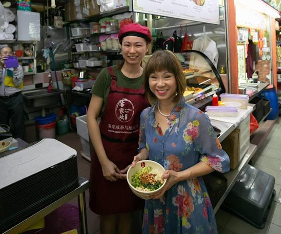 Senior Minister of State for the Environment and Water Resources Amy Khor with a young hawker at Chinatown Complex Food Centre. PHOTO: Amy Khor Facebook page