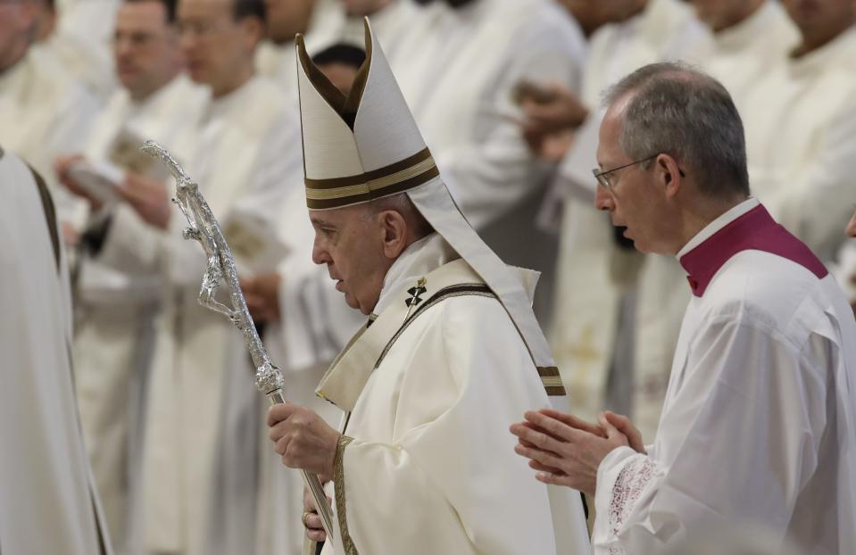 Pope Francis arrives to celebrate Chrism Mass, inside St. Peter's Basilica, at the Vatican, Thursday, April 18, 2019. During the Mass the Pontiff blesses a token amount of oil that will be used to administer the sacraments for the year. (AP Photo/Alessandra Tarantino)