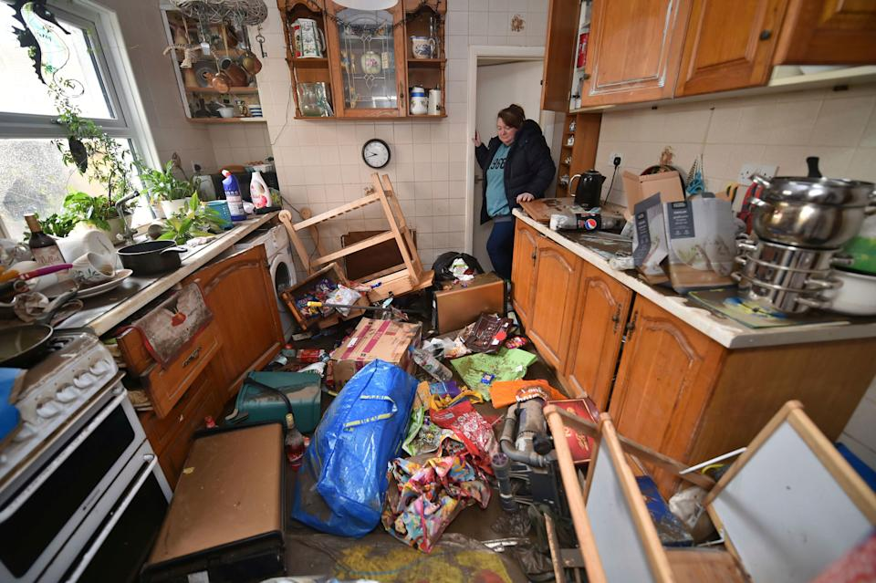 Rachel Cox inspecting flood damage in her kitchen in Nantgarw, south Wales. (Photo: ASSOCIATED PRESS)