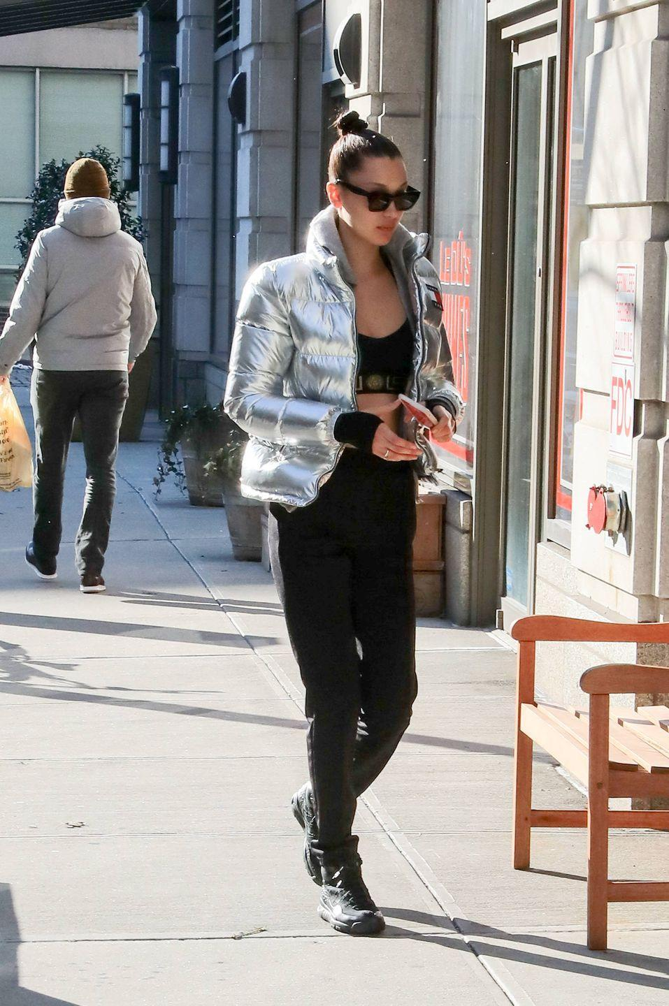 <p>Out in NYC in black pants and a black crop top and a silver Tommy Hilfiger puffer coat. </p>