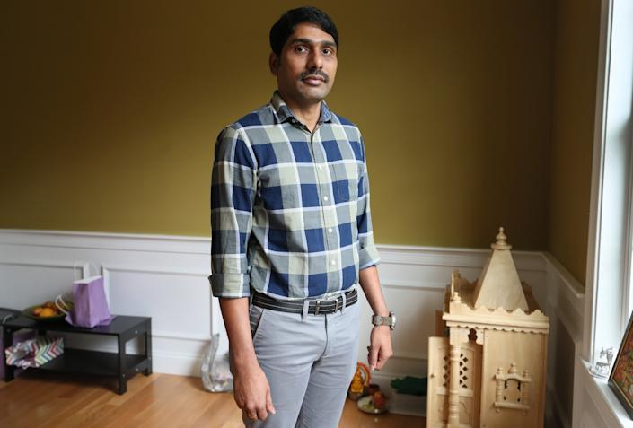 Srikanth Paladugu poses for a portrait in Hopkinton, MA on Aug. 31, 2018. Paladugu has been waiting for a green card since 2012. His application was approved several years ago, but because of an immigration backlog for Indian nationals, he has been unable to get permanent residency.  (Suzanne Kreiter/The Boston Globe via Getty Images)