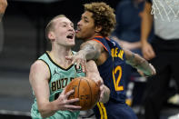 Charlotte Hornets guard Devonte' Graham, left, is fouled by Golden State Warriors guard Kelly Oubre Jr. during the second half of an NBA basketball game on Saturday, Feb. 20, 2021, in Charlotte, N.C. (AP Photo/Chris Carlson)