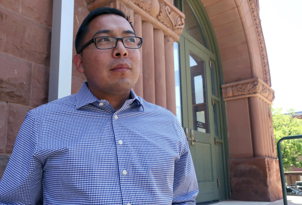 FILE - In this June 28, 2019, file photo, Tremayne Nez stands outside the Coconino County courthouse in Flagstaff, Ariz. In June 2019, police wrongfully arrested him on suspicion of selling LSD after they mistook Nez, who is Navajo, for the actual suspect, also Native American. After spending more than 30 hours in jail in 2019, he posted bond but his mug shot had already been released, tarnishing his reputation throughout the tribal community. Booking photos taken by police when a person is arrested are often made public, but some experts say releasing someone's mug shot can undermine the presumption of innocence, perpetuate stereotypes and leave a lasting virtual stain. (AP Photo/Felicia Fonseca, File)