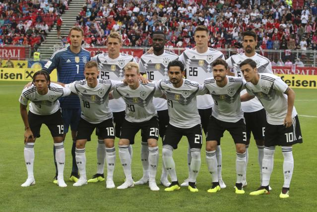 In this photo taken on Saturday, June 2, 2018, Germany team poses for photos before a friendly soccer match between Austria and Germany in Klagenfurt, Austria. (AP Photo/Ronald Zak)