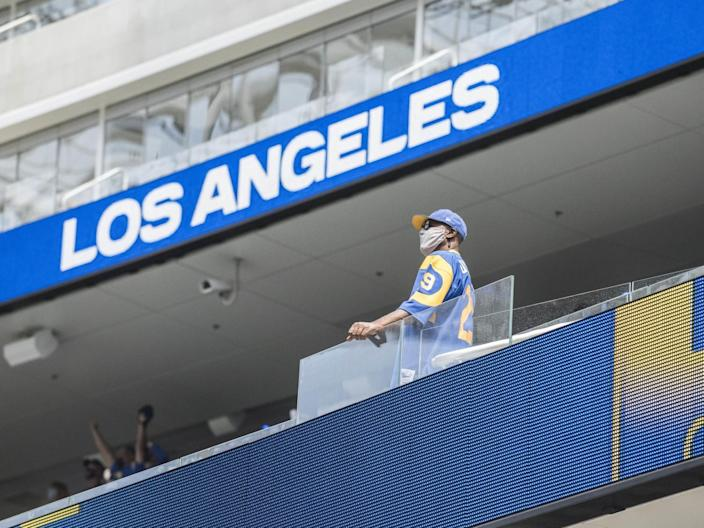 A Rams fan looks at the SoFi Stadium field in Inglewood on Saturday.