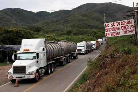 A general view shows cargo trucks queuing to cross a checkpoint of the Community Police in the municipality of San Diego Xayakalan