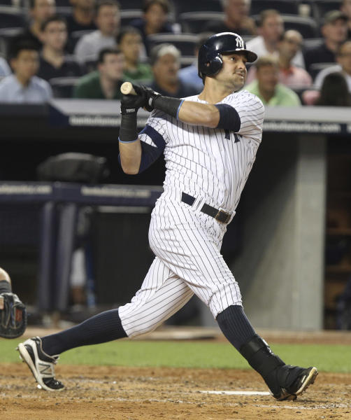 New York Yankees' Nick Swisher looks after his grand slam during the third inning of the baseball game against the Texas Rangers Monday, Aug. 13, 2012 at Yankee Stadium in New York. (AP Photo/Seth Wenig)