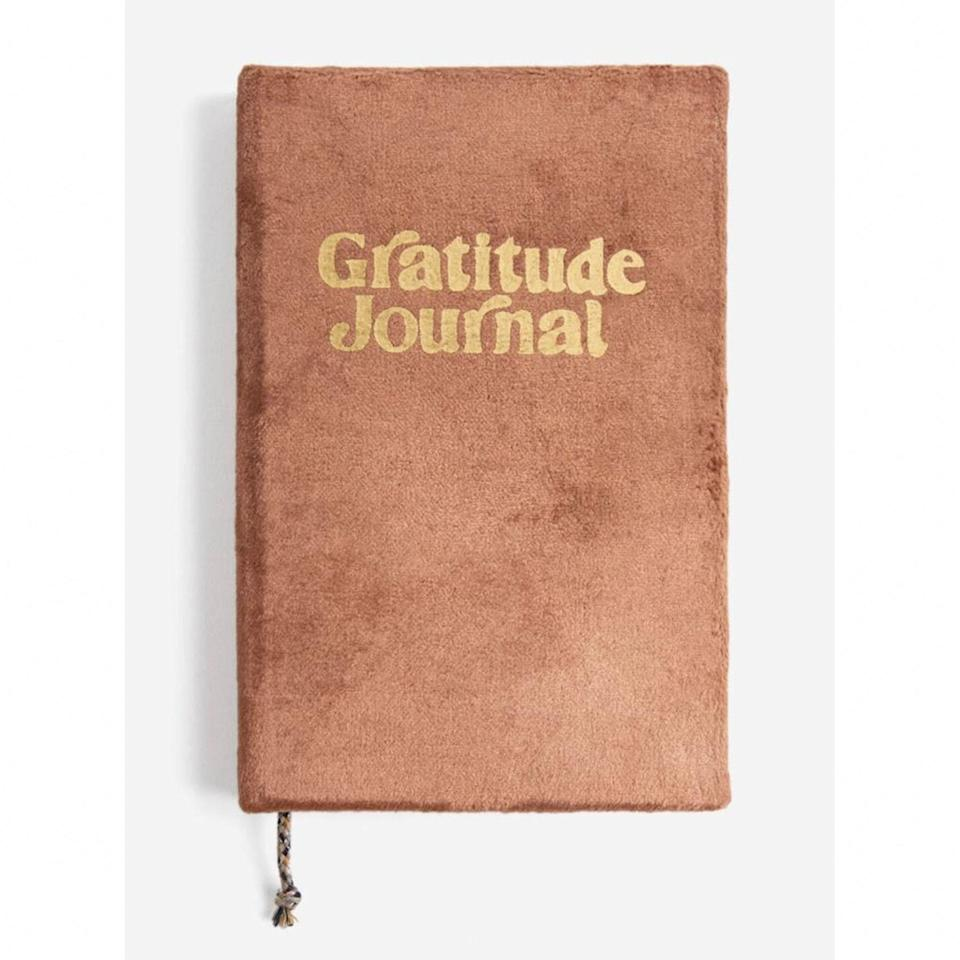 "Appreciate the magic in every day with the help of this crushed velvet journal with metallic gold foil design. It's got page prompts designs to inspire reflection and positivity, and the unconventional cover will add some texture to your meditation station. $20, South Moon Under. <a href=""https://www.southmoonunder.com/shop/p/gratitude-guided-journal-33535"" rel=""nofollow noopener"" target=""_blank"" data-ylk=""slk:Get it now!"" class=""link rapid-noclick-resp"">Get it now!</a>"