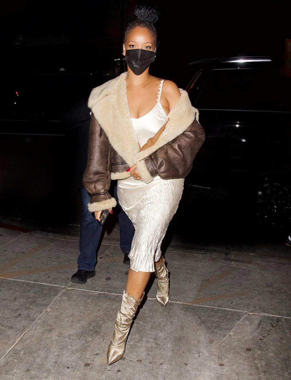 <p>Rihanna looks stunning in a pearlescent satin dress as she makes her way to dinner with friends on Tuesday night in L.A.</p>