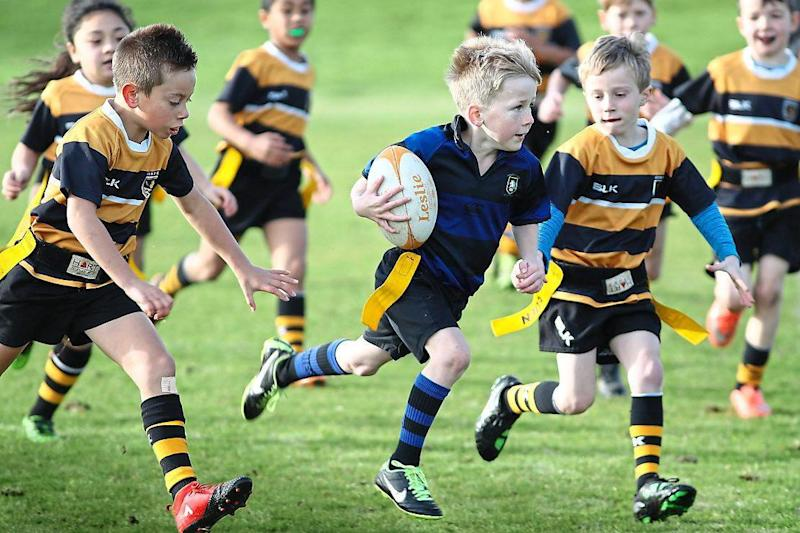 Catch me if you can | It's fun and games for these children on the rugby pitch: Phil Walter/Getty Images