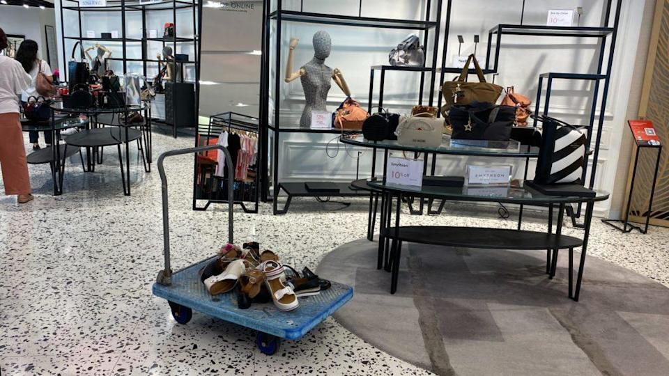 A random trolley of unwanted shoes at The Heeren outlet. Photo: Coconuts