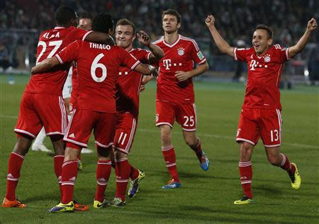Thiago (6) of Germany's Bayern Munich celebrates his goal against Morocco's Raja Casablanca with his team-mates during their 2013 FIFA Club World Cup final match at Marrakech stadium December 21, 2013. REUTERS/Youssef Boudlal