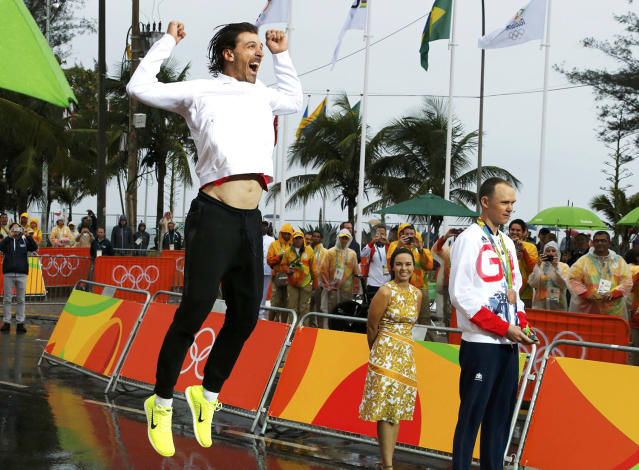 <p>Fabian Cancellara of Switzerland celebrates on podium after the men's individual time trial cycling event in Rio on August 10, 2016. (REUTERS/Eric Gaillard) </p>