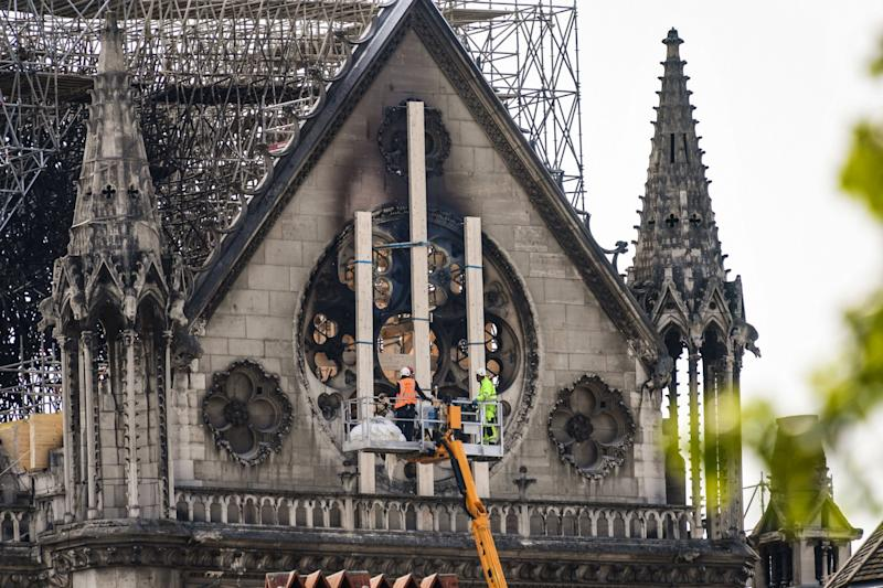 Workers set to secure vulnerable sections of the fire-damaged landmark (AFP/Getty Images)