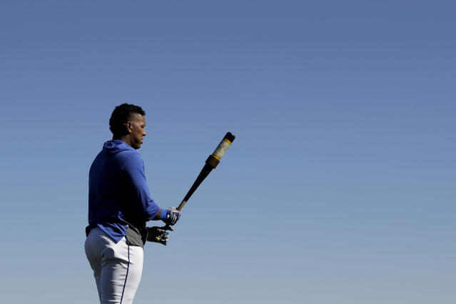Kansas City Royals' Salvador Perez gets ready to bat during spring training baseball practice Wednesday, Feb. 12, 2020, in Surprise, Ariz. (AP Photo/Charlie Riedel)