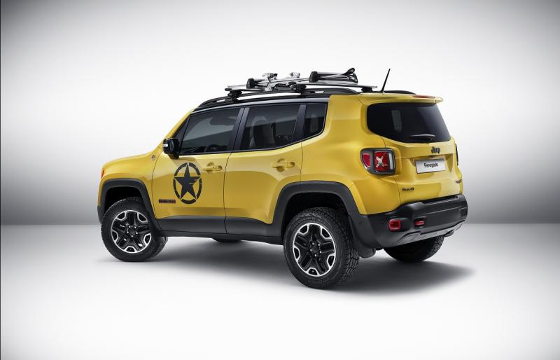 Yellow Jeep with star on the side, in a white room.
