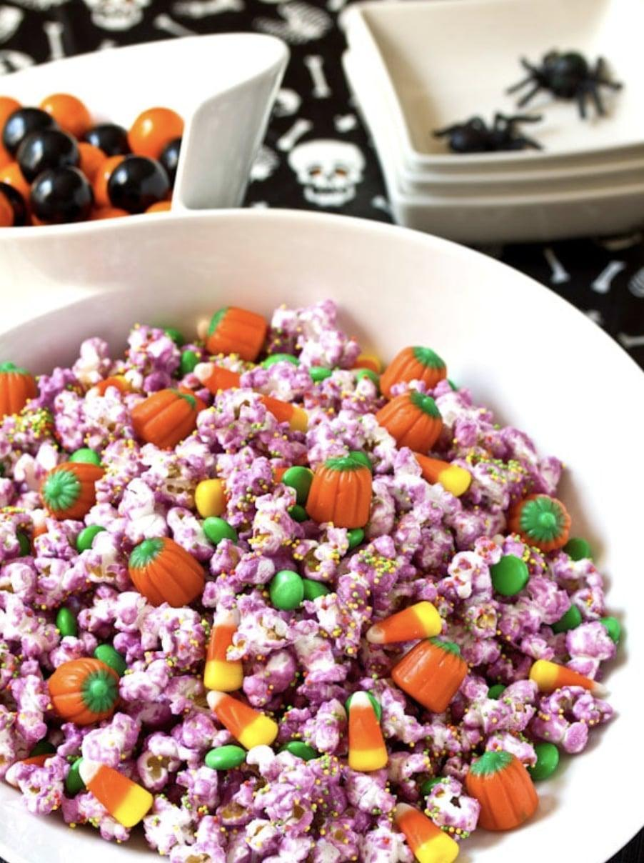 "<p>Who said popcorn had to be for dessert? This tasty snack is perfect to nibble on at any hour of the day. Fill this colorful party popcorn with your favorite <a class=""link rapid-noclick-resp"" href=""https://www.popsugar.co.uk/Halloween"" rel=""nofollow noopener"" target=""_blank"" data-ylk=""slk:Halloween"">Halloween</a> candies to really make it a treat!</p> <p><strong>Get the recipe:</strong> <a href=""https://www.aspicyperspective.com/halloween-party-popcorn-mix/"" class=""link rapid-noclick-resp"" rel=""nofollow noopener"" target=""_blank"" data-ylk=""slk:Halloween popcorn mix"">Halloween popcorn mix</a></p>"