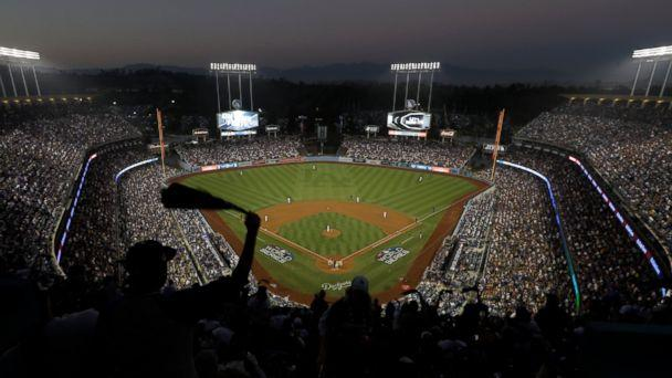PHOTO: Fans cheer from the top of Dodger Stadium during Game 4 of the World Series baseball game between the Boston Red Sox and Los Angeles Dodgers on Saturday, Oct. 27, 2018, in Los Angeles. (AP)