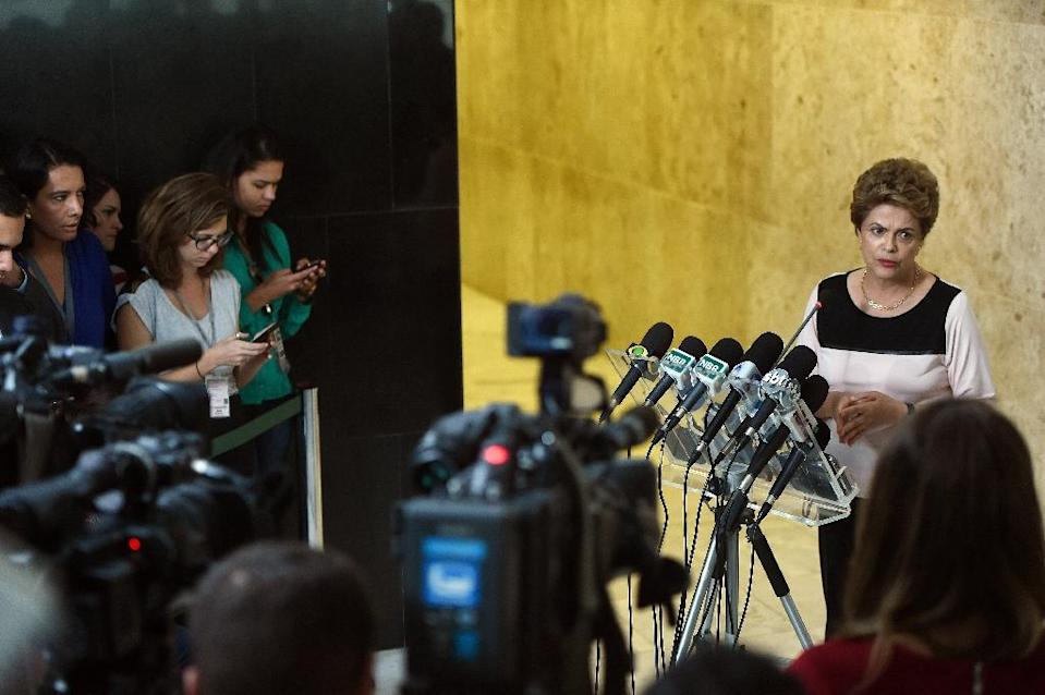 Brazilian President Dilma Rousseff speaks at Planalto Palace on December 7, 2015 as allies maneuvered behind the scenes and warned of a political storm building in Latin America's biggest country (AFP Photo/Evaristo Sa)