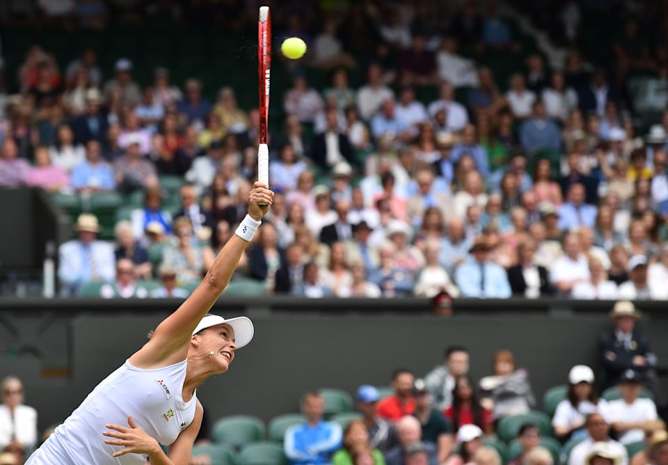 Germany's Tatjana Maria serves to Germany's Angelique Kerber during their women's singles first round match on the second day of the 2019 Wimbledon Championships at The All England Lawn Tennis Club in Wimbledon, southwest London, on July 2, 2019. (Photo by Glyn Kirk/AFP/Getty Images)