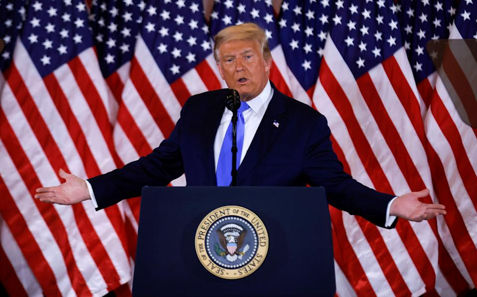 U.S. President Donald Trump speaks about early results from the 2020 U.S. presidential election in the East Room of the White House in Washington, U.S., November 4, 2020. REUTERS/Carlos Barria     TPX IMAGES OF THE DAY