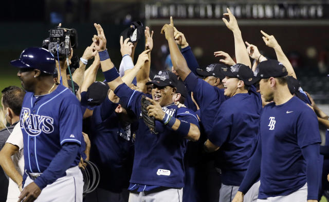 The Tampa Bay Rays celebrate after beating the Texas Rangers 5-2 at an American League wild-card tiebreaker baseball game Monday, Sept. 30, 2013, in Arlington, Texas. The Rays advance to face the Cleveland Indians in the American League wild-card playoff. (AP Photo/Tony Gutierrez)