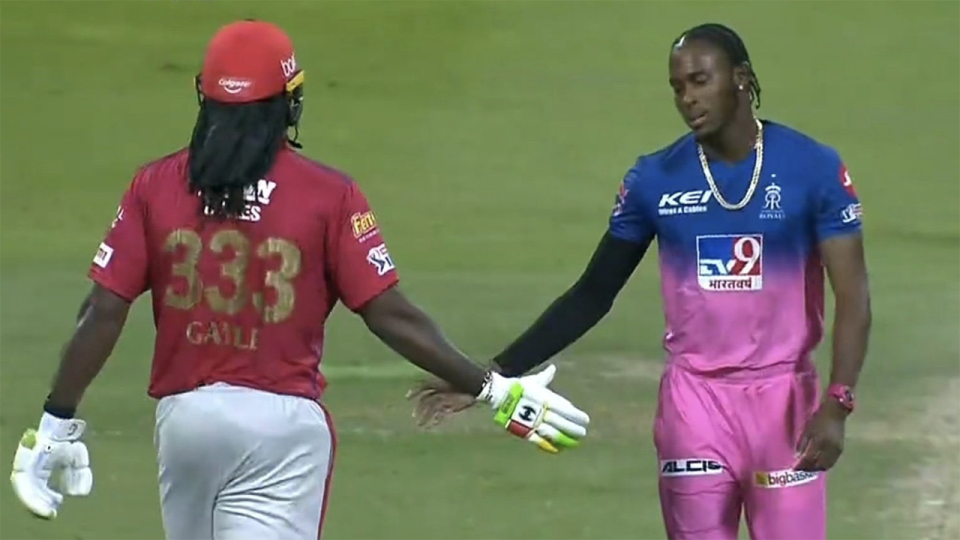 Chris Gayle is pictured shaking hands with Jofra Archer.