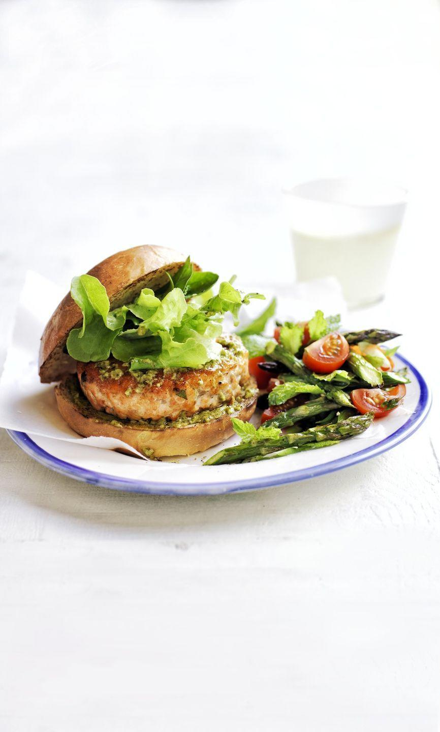 "<p>You can make this dish ahead of time by forming the patties and freezing them for up to 1 month. Cook from frozen at 425 degrees F until warm and cooked through, 15 to 20 minutes. Plus, salmon contains heart-healthy <a href=""https://www.heart.org/en/healthy-living/healthy-eating/eat-smart/fats/fish-and-omega-3-fatty-acids"" rel=""nofollow noopener"" target=""_blank"" data-ylk=""slk:omega-3 fatty acids"" class=""link rapid-noclick-resp"">omega-3 fatty acids</a>.</p><p><a href=""https://www.womansday.com/food-recipes/food-drinks/recipes/a50193/pesto-salmon-burgers-asparagus-tomato-salad-recipe-wdy0515/"" rel=""nofollow noopener"" target=""_blank"" data-ylk=""slk:Get the Pesto Salmon Burgers with Asparagus and Tomato Salad recipe."" class=""link rapid-noclick-resp""><em><strong>Get the Pesto Salmon Burgers with Asparagus and Tomato Salad recipe.</strong></em></a></p>"