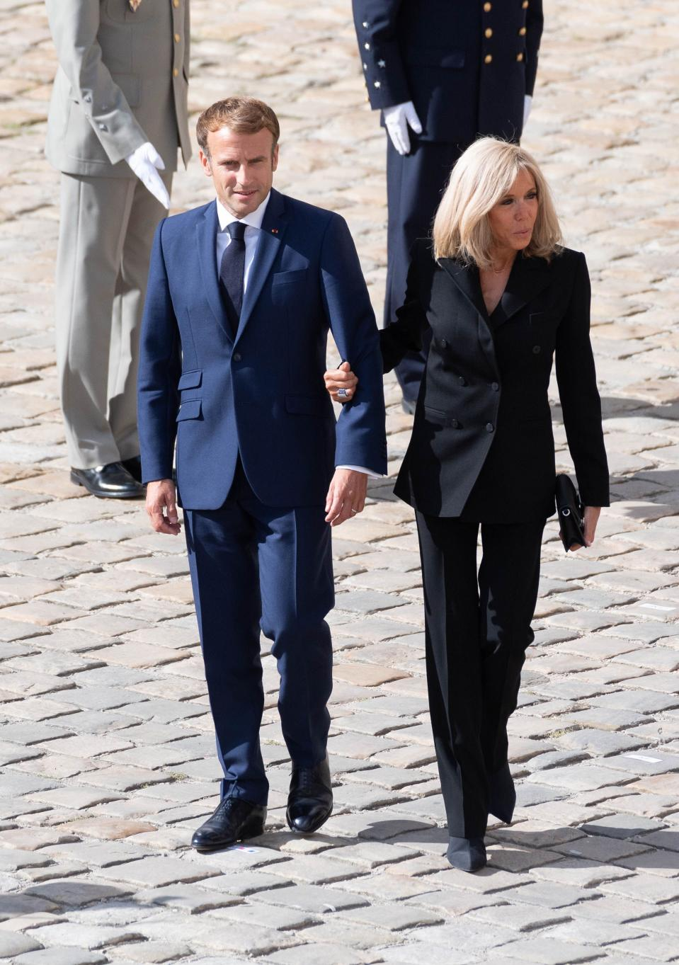 French President Emmanuel Macron (left) and his wife Brigitte Macron during the national tribute ceremony for deceased French actor Jean-Paul Belmondo at the monument of the Hôtel des Invalides in Paris on September 9, 2021. - Credit: Jacques WITT / SIPA