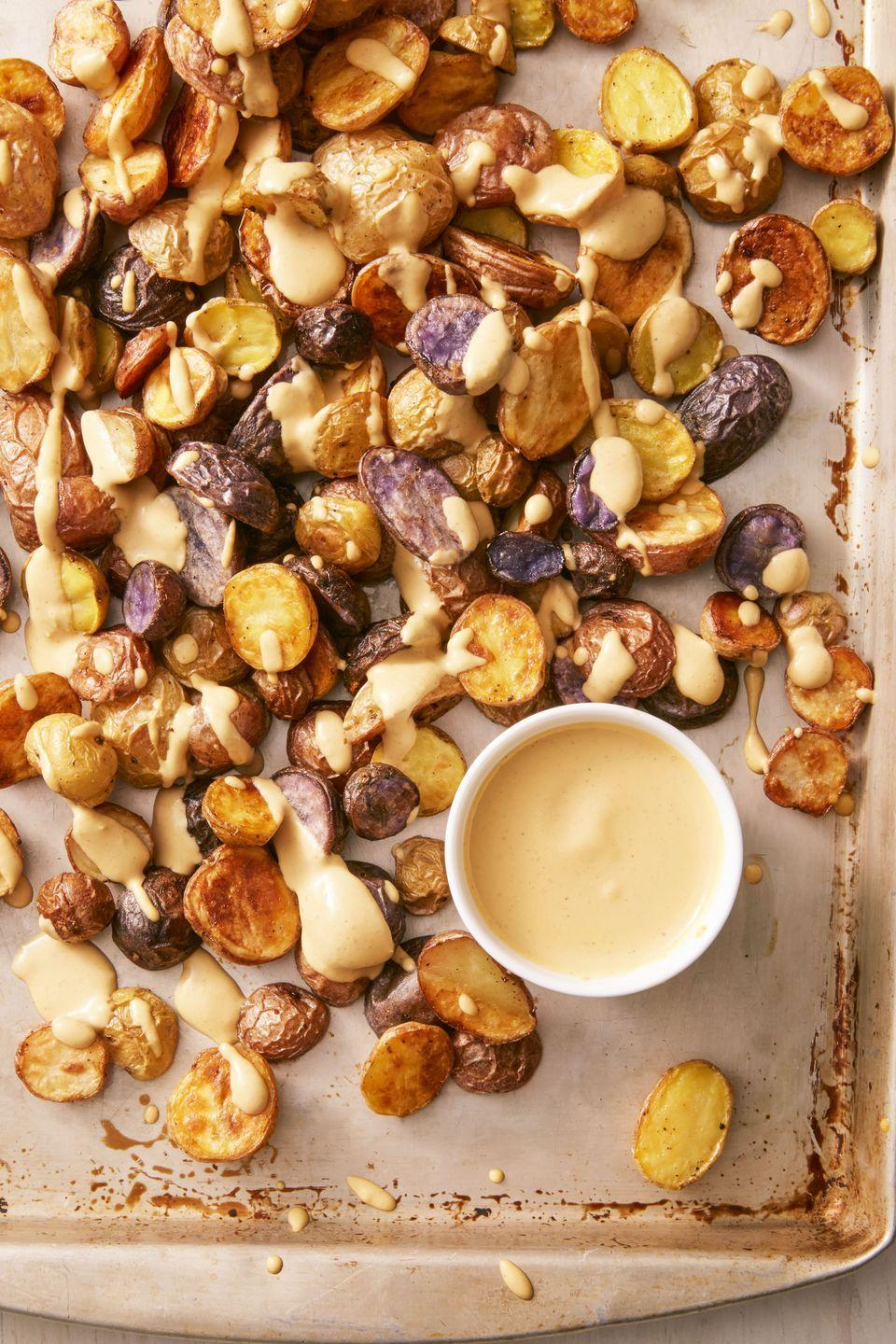 """<p>You'll never guess this nacho sauce is vegan, and you'll definitely want to slather it on potatoes, veggies or whatever you can get your hands on.</p><p><span class=""""redactor-invisible-space""""><span class=""""redactor-invisible-space""""><span class=""""redactor-invisible-space""""><span class=""""redactor-invisible-space""""><span class=""""redactor-invisible-space""""><em><a href=""""https://www.goodhousekeeping.com/food-recipes/easy/a36256/crispy-potatoes-with-vegan-nacho-sauce/"""" rel=""""nofollow noopener"""" target=""""_blank"""" data-ylk=""""slk:Get the recipe for Crispy Potatoes with Vegan Nacho Sauce »"""" class=""""link rapid-noclick-resp"""">Get the recipe for Crispy Potatoes with Vegan Nacho Sauce » </a></em></span></span></span></span></span><span class=""""redactor-invisible-space""""><span class=""""redactor-invisible-space""""><span class=""""redactor-invisible-space""""><span class=""""redactor-invisible-space""""><span class=""""redactor-invisible-space""""><br></span></span></span></span></span></p>"""