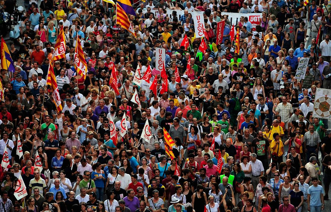 Demonstrators protest against austerity measures announced by the Spanish government in Barcelona, Spain, Thursday, July 19, 2012. The country is in its second recession in three years and its government borrowing rates are unsustainably high as investors worry the government may face new costs in rescuing the banks. If the government's borrowing rates do not fall back down, it may eventually need a sovereign bailout like those taken by Greece, Ireland and Portugal. (AP Photo/Manu Fernandez)